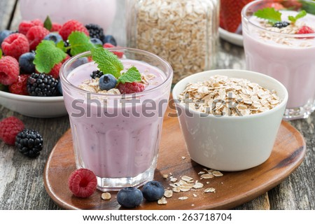 berry smoothie with oatmeal in a glass, horizontal - stock photo
