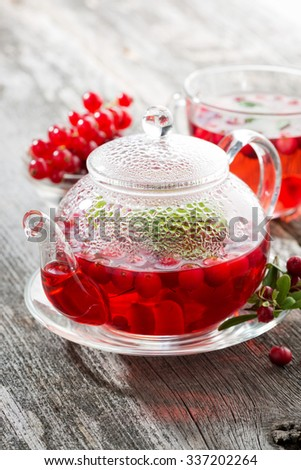 berry tea on wooden table, vertical - stock photo