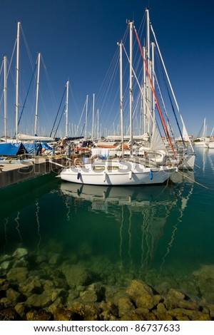 Berthed ships and yachts in the green bay in Sukosan marina - stock photo