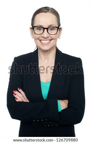 Bespectacled woman posing confidently. Isolated against white background. - stock photo