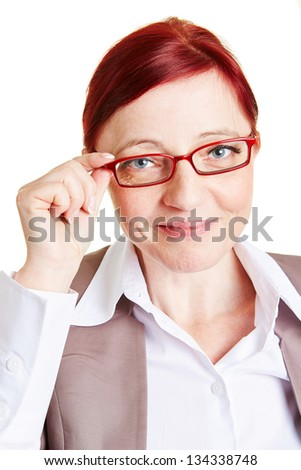 Best ager business woman smiling and touching spectacles of her glasses - stock photo