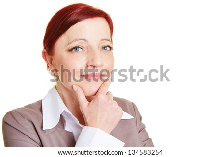 Best ager business woman thinking with a hand on the chin - stock photo