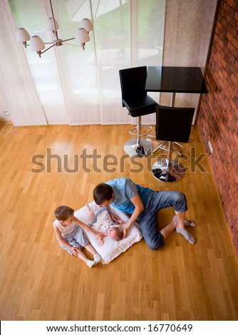 Best daddy. Father babysitting 4 years old son and newborn daughter - stock photo