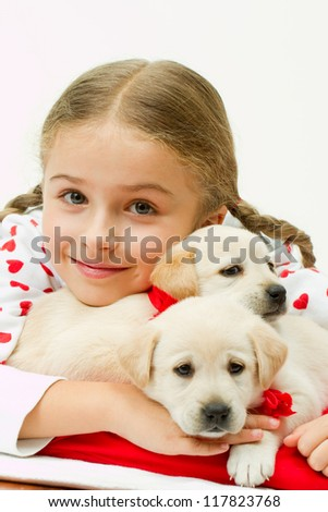 Best friends, happy childhood - lovely girl with cute puppies - stock photo