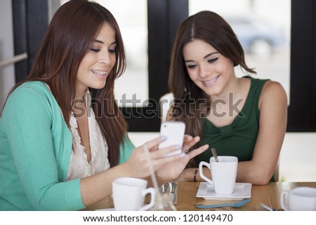 Best friends having fun and enjoying a cup of coffee