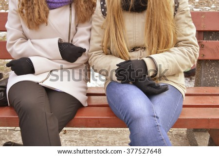 Best friends in a city park. Girl walking in the park together. Lovely romantic girlfriend female students.