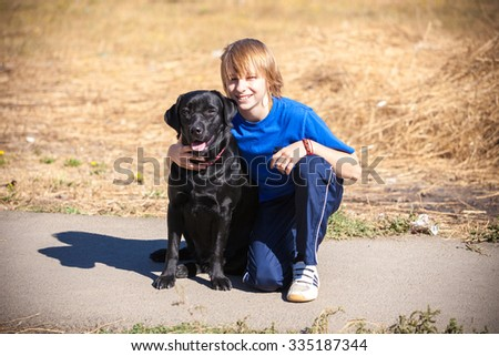 Best friends - Little boy with dog at the nature - stock photo