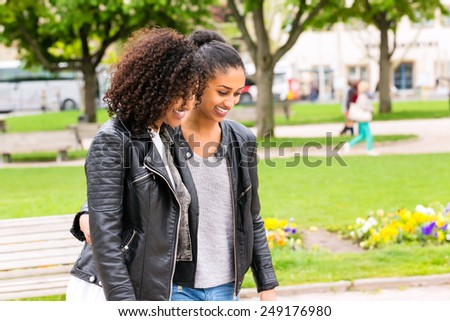 Best friends of North African ethnicity in park - stock photo