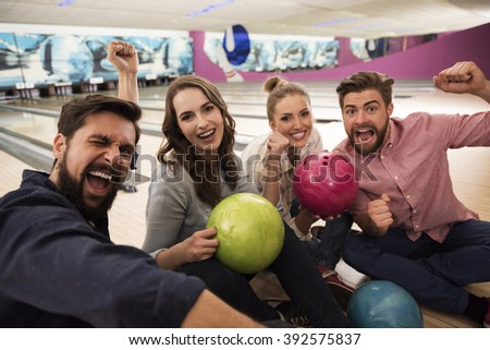 Best friends spending time on bowling