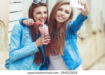 best friends taking a picture yourself in urban city context.  - stock photo