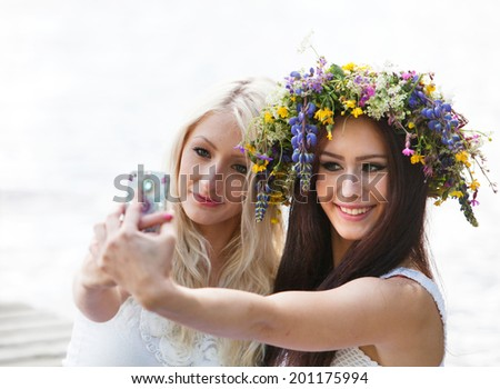 Best friends taking a selfie with the phone - stock photo