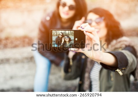 Best friends taking Selfie With Mobile Phone - stock photo
