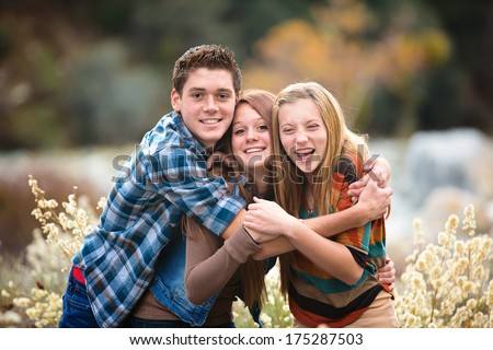 Best friends, teens laughing and hugging