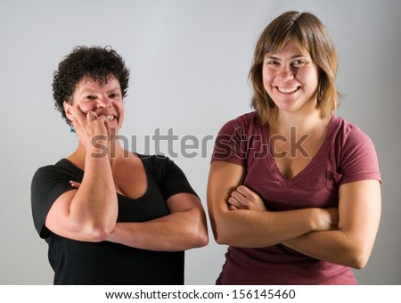 Best friends: two women (African American, 40s, Caucasian, 20s) share a laugh together - stock photo