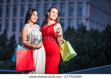 Best Friends. Two young woman shopping - stock photo