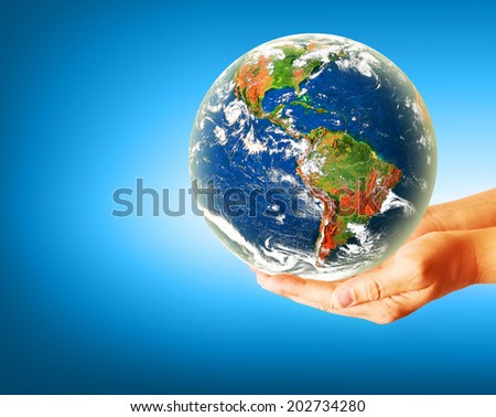 Best Internet Concept of global business from concepts series. Globe on her hands, South and North America. Elements of this image furnished by NASA