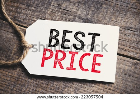 Best Price on blank tags. Red inscription Best Price on blank tags on wooden table  - stock photo