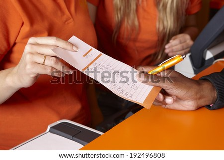Bet tickets detail with hands and pen. Horizontal - stock photo