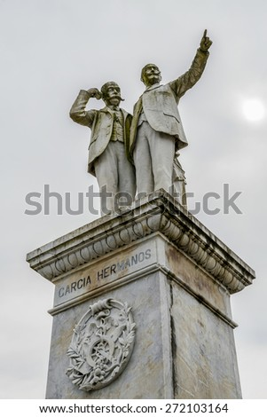 BETANZOS, SPAIN - MARCH 29, 2015: Statue of Hermanos Garcia were some Spanish philanthropists, prominent benefactors of Betanzos, where they founded many charities in the early twentieth century. - stock photo