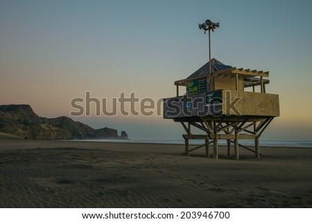 Bethells Beach (Te Henga), Auckland with lifeguard hut  - stock photo