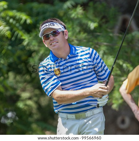 BETHESDA, MD - JUNE 15: Louis Oosthuizen hits a drive on Congressional during the 2011 US Open on June 15, 2011 in Bethesda, MD. - stock photo