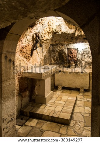 BETHLEHEM, Israel, July 12, 2015: The city of Bethlehem. Cross in the grotto of St. Jerome in the area of the Church of St. Catherine and close to the Basilica of the Nativity of the birth of Jesus