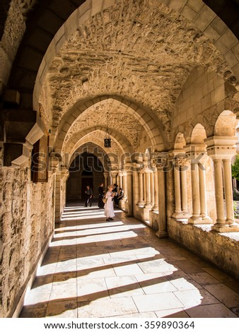 BETHLEHEM, ISRAEL - JULY 12, 2015: The gothic corridor of atrium at St. Catharine church - stock photo