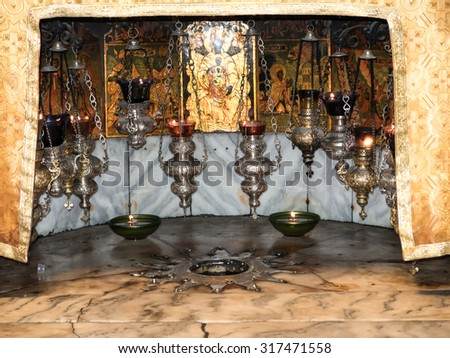BETHLEHEM - JULY 12, 2015, ISRAEL: A silver star marks the traditional site of the birth of Jesus in Bethlehem's Church of the Nativity, Bethlehem, Israel on July 12, 2015. - stock photo