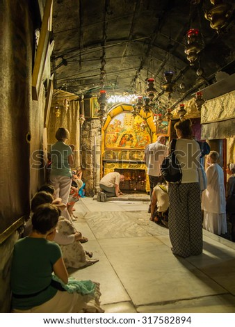 BETHLEHEM - JULY 12, 2015, ISRAEL: The traditional site of the birth of Jesus in Bethlehem's Church of the Nativity, Bethlehem, Israel on July 12, 2015. - stock photo