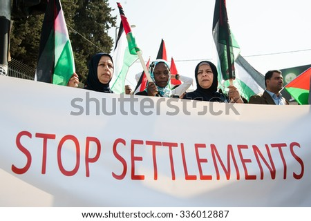 BETHLEHEM, OCCUPIED PALESTINIAN TERRITORIES - NOVEMBER 6: Palestinians protest Israeli settlements in the midst of peace negotiations between Israeli and Palestinian leaders, November 6, 2013.