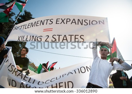 BETHLEHEM, OCCUPIED PALESTINIAN TERRITORIES - NOVEMBER 6: Palestinians protest Israeli settlements in the midst of peace negotiations between Israeli and Palestinian leaders, November 6, 2013.  - stock photo