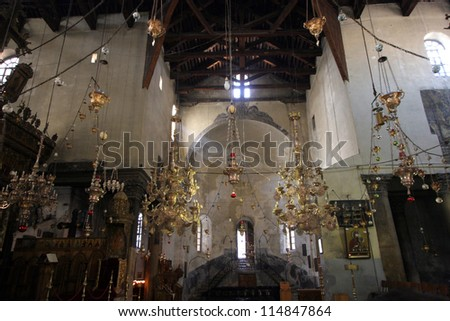 BETHLEHEM - OCTOBER 05: The Basilica of the Nativity is one of Bethlehem's major tourist attractions and a magnet for Christian pilgrims, Bethlehem, Israel on October 05, 2006. - stock photo