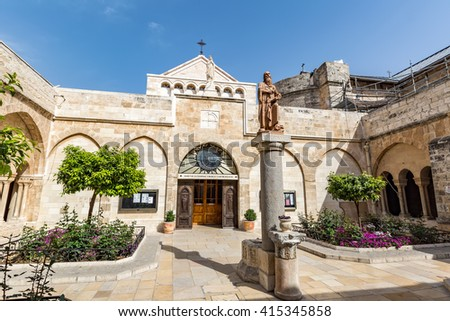BETHLEHEM, PALESTINE - APRIL 6, 2016: The statue to the St. Jerome located in the middle of the inner courtyard of the Church of the Nativity, on April 6 in Bethlehem.