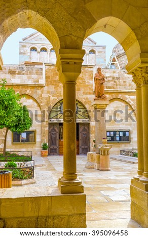 BETHLEHEM, PALESTINE - FEBRUARY 18, 2016: The statue to the St. Jerome located in the middle of the inner courtyard of the Church of the Nativity, on February 18 in Bethlehem.