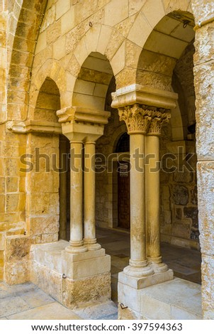 BETHLEHEM, PALESTINE - FEBRUARY 18, 2016: The stone columns and arches of the courtyard of the Church of the Nativity, on February 18 in Bethlehem.