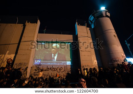 BETHLEHEM, PALESTINIAN TERRITORY - NOVEMBER 29: Palestinians watch Prime Minister Mahmoud Abbas's speech for Palestine's UN bid, at the Israeli separation wall in Bethlehem, West Bank, Nov. 29, 2012.