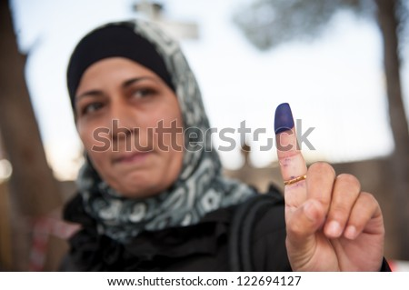 BETHLEHEM, PALESTINIAN TERRITORY - OCTOBER 20: A woman shows her ink-stained finger, indicating that she has voted in Palestinian municipal elections, Bethlehem, West Bank, Oct. 20, 2012.