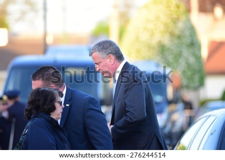 BETHPAGE, LONG ISLAND - MAY 7 2015: a formal viewing for slain NYPD officer Brian Moore, attended by thousands of police officers from North America. Mayor Bill de Blasio arrives in Bethpage. - stock photo