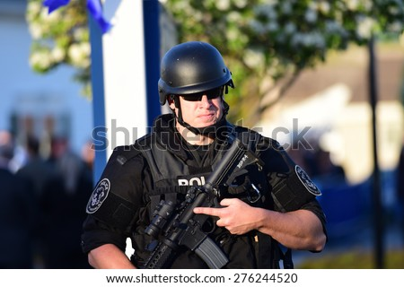 BETHPAGE, LONG ISLAND - MAY 7 2015: a formal viewing for slain NYPD officer Brian Moore, attended by thousands of police officers from North America. Heightened security at funeral home - stock photo