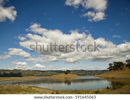 Beutiful landscape with blue sky and white clouds, Sunshine, mountains and lake