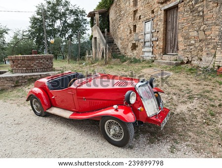 """BEVAGNA, ITALY - SEPTEMBER 8: british roadster car Armstrong Siddeley IN classic car rally during the festival """"Festa di fine Estate"""" on September 8, 2013 in Bevagna, PG, Italy - stock photo"""