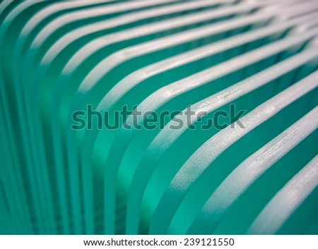 beveled and frosted glasses in a row. glass dull glass shelves in factory production line. - stock photo