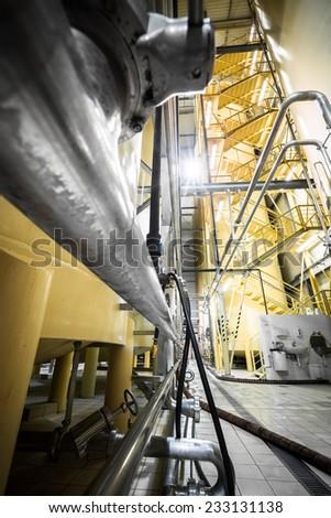 beverage manufacture, poor light - stock photo