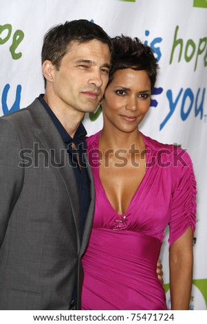 BEVERLY HILLS - APR 17: Halle Berry, Olivier Martinez at the Silver Rose Awards Gala held at the Beverly Hills Hotel, Beverly Hills, California on April 17, 2011. - stock photo