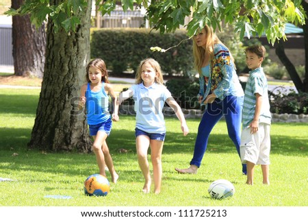 "BEVERLY HILLS - AUG 31: Cindy Margolis who currently stars  in ABC Family's ""Beverly Hills Nannies"" is relaxing at the park on August 31, 2012 in Beverly Hills, California"