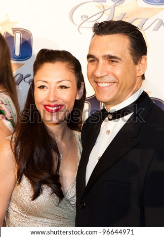 BEVERLY HILLS, CA - FEB. 26: Designer Alexandra Tonelli & actor Adrian Paul arrive for the 22nd Annual Night Of 100 Stars event held at The Beverly Hills Hotel on Feb. 26, 2012 in Beverly Hills, CA. - stock photo