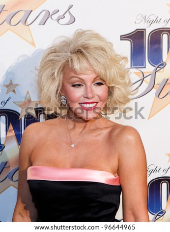 BEVERLY HILLS, CA - FEB. 26: Marilyn Monroe impersonator Sunny Thompson arrives for the 22nd Annual Night Of 100 Stars event held at The Beverly Hills Hotel on Feb. 26, 2012 in Beverly Hills, CA. - stock photo