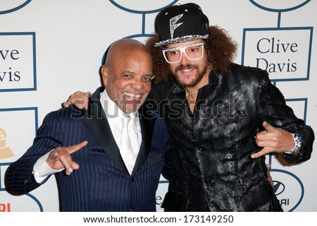 BEVERLY HILLS, CA. - JANUARY 25: Berry Gordy & son Red Foo arrive at the Clive Davis & The Recording Academy annual Pre-GRAMMY Gala on January 25th 2014 at the Beverly Hilton in Beverly Hills. - stock photo