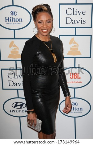 BEVERLY HILLS, CA. - JANUARY 25: MC Lyte arrives at the Clive Davis and The Recording Academy annual Pre-GRAMMY Gala on January 25th 2014 at the Beverly Hilton in Beverly Hills, California. - stock photo