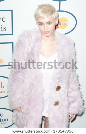 BEVERLY HILLS, CA. - JANUARY 25: Miley Cyrus arrives at the Clive Davis and The Recording Academy annual Pre-GRAMMY Gala on January 25th 2014 at the Beverly Hilton in Beverly Hills, California. - stock photo